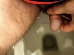 Calm penis and morning urine in the toilet.