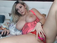 Busty blonde strips and shows her naked body